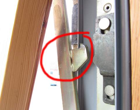 the circled latch is freed from the black bracket and the window can swing open