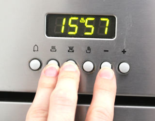 Hold down 2nd and 3rd buttons from the left and press the minus sign to decrease the time