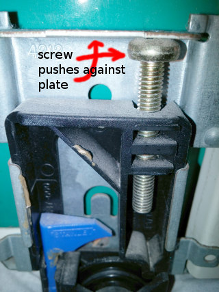 The screw head pushes against the plate to give the wheel height