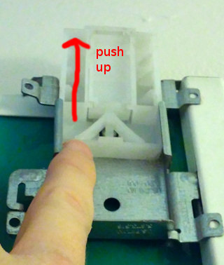 Push up the sliding mechanism until you hear it click