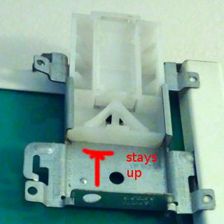 Sliding mechanism on top of door should stay in place in elevated position