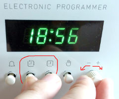 Twist the knob to set the time while holding the 2nd and 3rd buttons from the left
